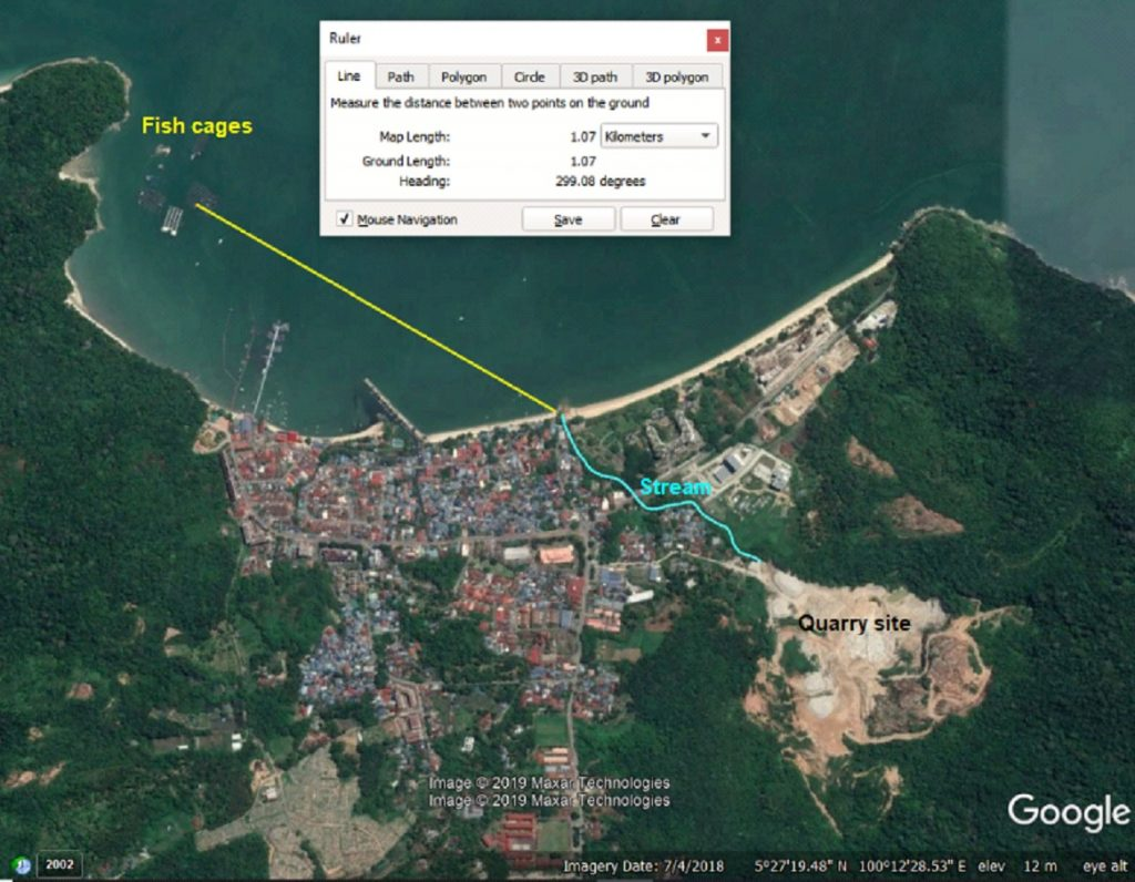satellite image shows the illegal quarry nearby the Teluk Bahang bay, where thousands of fishes have recently been reported poisoned by heavy metals. The quarry is measured to be sited 1km from the sea.